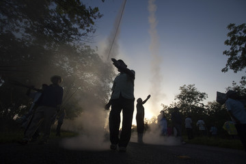 Parishioners launch fireworks during a procession of the Black Christ of Exaltation in Sitilpech