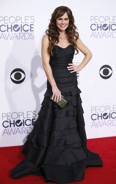 """Nikki DeLoach from MTV's sitcom """"Awkward"""" arrives at the 2015 People's Choice Awards in Los Angeles"""