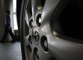Toyota Motor Corp's symbol on a wheel of a car is seen at its showroom in Tokyo