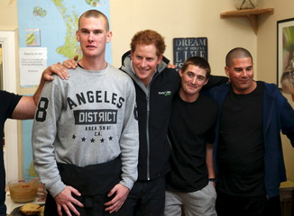 Britain's Prince Harry poses for a picture with residents of Odyssey House, a facility to support and educate those with drug and alcohol addictions, in Christchurch