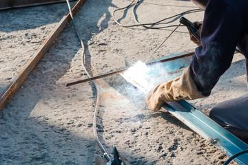 tame welder. the welder welds iron. the welder welds metal.