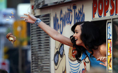 U.S. musician Katy Perry throws a cone as she arrives in an ice cream truck at the 2010 MuchMusic Video Awards in Toronto