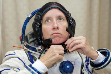 U.S. astronaut Walker prepares for a training session at the Star City space centre outside Moscow