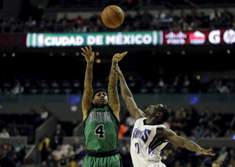 Isaiah Thomas of Boston Celtics jumps for the ball with Darren Collison of Sacramento Kings during their NBA Global Games basketball game in Mexico City