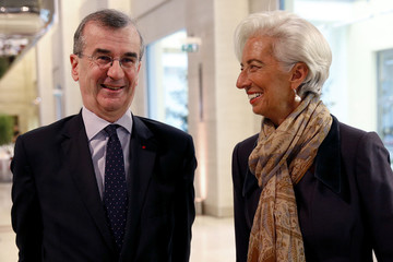 Banque de France Governor Villeroy de Galhau and IMF Managing Director Lagarde pose prior to the opening of a farewell symposium for former Governor Noyer on ultra low interest rates and challenges for central banks in Paris