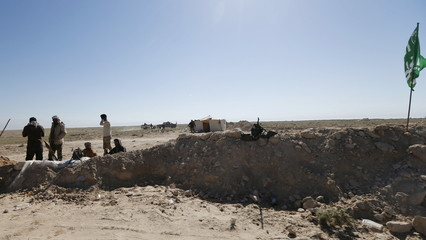 Shi'ite fighters gather during a military operation in the west of Samarra, in the desert of Anbar