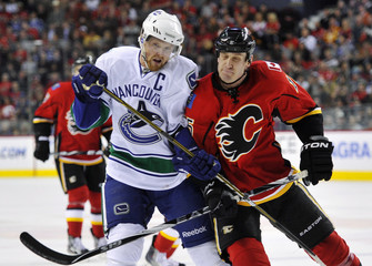 Flames' Jackman hits Canucks' Sedin during the second period of their NHL hockey game in Calgary