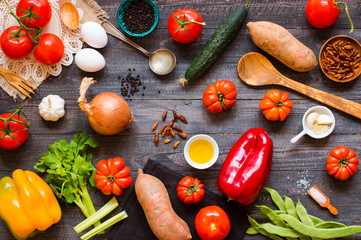 Different types of vegetables, on a old wooden table, space for text.