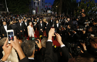 """Cast members Juliette Binoche and Kristen Stewart pose on the red carpet as as they leave after the screening of the film """"Sils Maria""""  in competition at the 67th Cannes Film Festival in Cannes"""