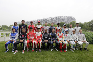 Drivers from 10 teams pose for an official group photo ahead of the upcoming Formula E Championship race in Beijing