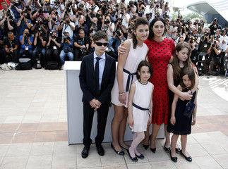 """Cast members Luis Huilca, Maria Alexandra Lungu, Eva Morrow, Monica Bellucci, Agnese Graziani and Maria-Stella Morrow pose during a photocall for the film """"Le meraviglie"""" in competition at the 67th Cannes Film Festival in Cannes"""