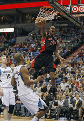Toronto Raptors guard Terrence Ross dunks over Minnesota Timberwolves forward Dante Cunningham during their NBA game in Minneapolis