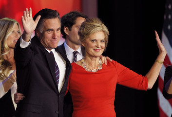 U.S. Republican presidential nominee Mitt Romney stands on stage with his wife Ann during his election night rally in Boston