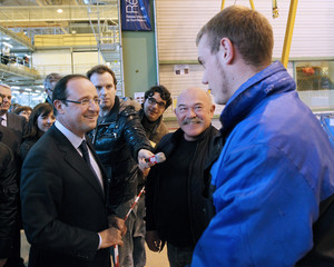 Francois Hollande, France's Socialist Party candidate for the 2012 French presidential election, speaks to employees as he visits an Airbus assembly line in Saint-Nazaire