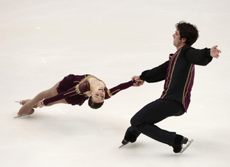 Marley and Brubaker of the U.S. perform during the pairs short program competition at the ISU Four Continents Figure Skating Championships in Taipei