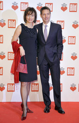 Deutsche Telekom CEO Obermann and his wife TV presenter Illner arrive for A Heart for Children TV charity telethon in Berlin