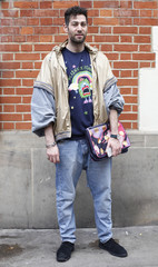 """Glazin, a fashion blogger, editor and writer, poses outside the main catwalk venue for """"London Collections: Men"""" in London"""