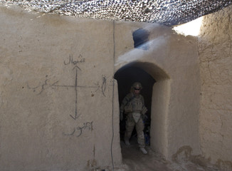 A U.S. Army soldier of 5-20 Infantry Regiment attached to 82nd Airborne Division, walks in an Afghan security forces compound in Zharay district