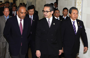 ASEAN foreign ministers walk for a photo session in Bali
