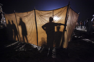 Paramilitary forces construct a barrier around the scene of a blast in Karachi's Clifton beach