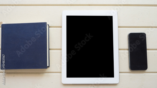 Wall mural top view with taplet and smart phone on wood background