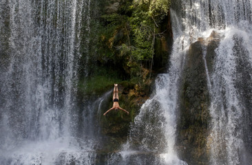 A competitor takes part in the first international waterfall jumping competition held in the old town of Jajce