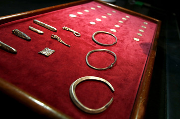 A Viking Hoard, silver arm-rings, silver ingots and rare coins of King Alfred of Wessex and King Ceolwulf II of Mercia, on show at the British Museum London