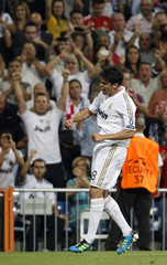 Real Madrid's Kaka celebrates his goal against Ajax Amsterdam during their Champions League Group D soccer match at the Santiago Bernabeu stadium in Madrid