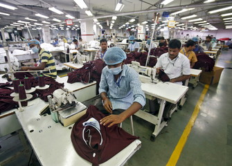 Employees work inside a garment factory of Orient Craft Ltd in Gurgaon