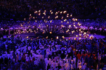 Stems lit by seven young athletes raise to form the The Olympic cauldron during the opening ceremony of the London 2012 Olympic Games at the Olympic stadium