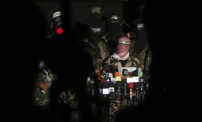 Members of Palestinian armed factions take part in a news conference in Gaza City