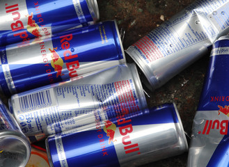 Red Bull drink cans are pictures inside a metal recycle container in Vienna