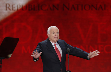 U.S. Senator John McCain gestures as he arrives to address the third session of the Republican National Convention in Tampa