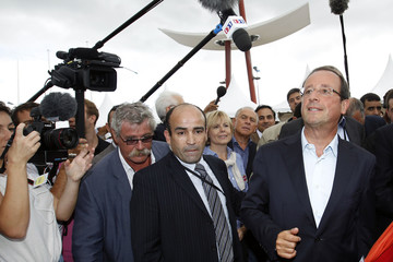 Candidate for the 2011 French Socialist Party presidential primary Hollande arrives at the summer meeting of the French Socialist Party in La Rochelle