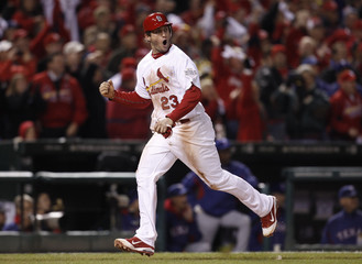 St. Louis Cardinals baserunner Freese celebrates as he runs to score against the Texas Rangers during the seventh inning in Game 2 of MLB's World Series baseball championship in St. Louis