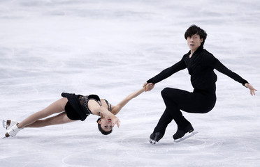 Pang Qing and Tong Jian of China perform during their pairs short program at the ISU Bompard Trophy event at Bercy in Paris
