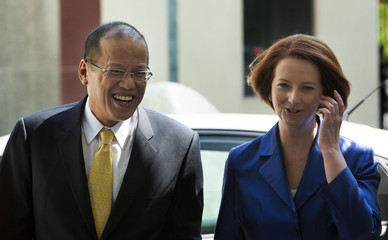 Australia's PM Gillard greets Philippine President Aquino before their meeting in Canberra