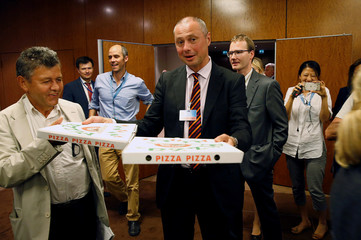 Pizzas are delivered to reporters awaiting John Kerry and Russian Foreign Minister Sergei Lavrov to hold a press conference in Geneva