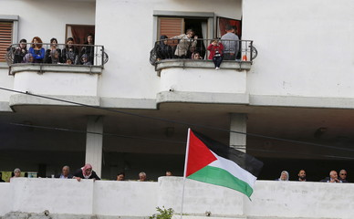 Israeli Arab demonstrators take part in a Land Day rally in the northern village of Deir Hanna