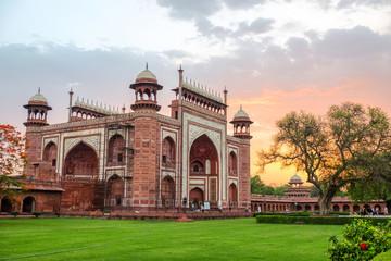 Taj Mahal's western gate at sunrise, Agra, India
