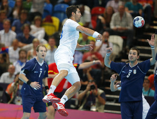 France's Nikola Karabatic scores a goal against Argentina in their men's handball Preliminaries Group A match at the Copper Box venue during the London 2012 Olympic Games