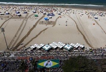 Demonstrators wave a Brazilian flag with a drawing of President Dilma Rousseff (bottom) during an anti-government demonstration in Copacabana in Rio de Janeiro