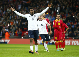 England's Daniel Sturridge celebrates after scoring a penalty against Montenegro during their 2014 World Cup qualifying soccer match at Wembley Stadium in London