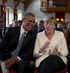 U.S. President Obama and German Chancellor Merkel attend a concert at the hotel castle Elmau in Kruen