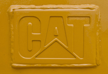 A welded steel CAT logo is seen on a Caterpillar tractor scraper at Holt Caterpillar, the largest Caterpillar dealer in the United States, in San Antonio