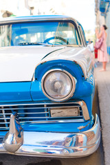 HAVANA, CUBA - APRIL 14, 2017: Closeup of blue classic vintage car in Old Havana, Cuba. The most popular transportation for tourists are used as taxis.