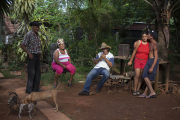 A family relax in their ranch near San Antonio de los Banos village in Artemisa province