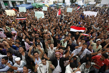 Anti-government protesters shout slogans during a rally to demand the ouster of Yemen's President Ali Abdullah Saleh in Sanaa