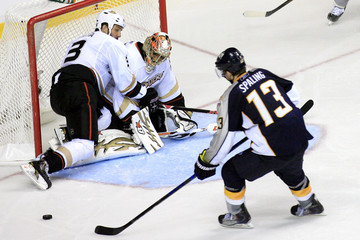 Predators' Spaling retrieves a deflection to score the series winning goal on Ducks' Emery and Lilja in Nashville