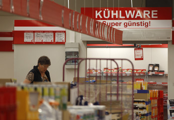 A woman looks at goods in a supermarket in the western city of Herne